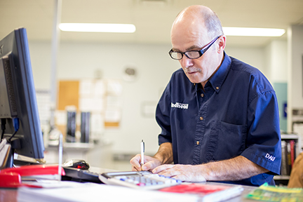 Parts desk employee from Swift Current